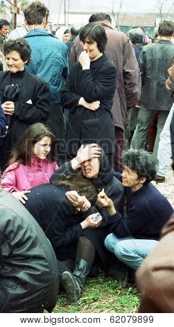 MALI, BOSNIA - MAR 19: A funeral for five Bosnian Serb men killed the night before by Bosnian Muslim troops near in Mali Zvornik, Bosnia, on March 19, 1992.