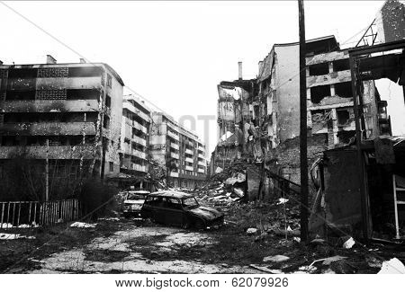 SARAJEVO, BOSNIA - MAR 15: Crushed cars and the  debris of war litter the destroyed streets of  Sarajevo, Bosnia, on Friday, March 15, 1996.