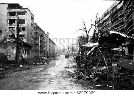 SARAJEVO, BOSNIA - MAR 15: Crushed buses and the  debris of war line a street of blown up buildings in Sarajevo, Bosnia, on Friday, March 15, 1996.