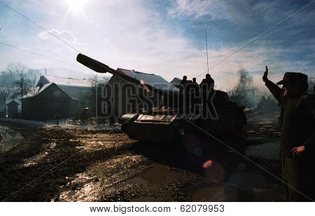 MODRICA, BOSNIA - JAN 8: A Bosnian Serb T-54 tank passes through Modrica, Bosnia, on Friday, January 8, 1995. The tank had just taken part in an extensive ethnic cleansing operation south of Modrica.