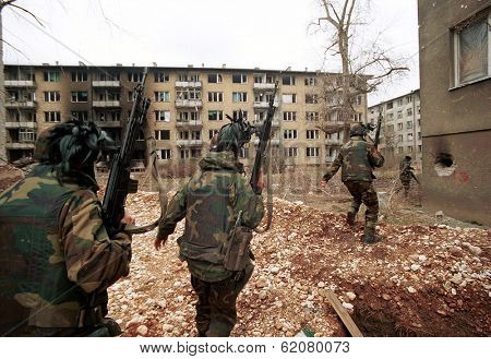 SARAJEVO, BOSINA - MARCH 18: Italian troops, in Bosnia as part of a NATO force, patrol an apartment house in the Serb area of Sarajevo  on Mar 18, 1993 in Sarajevo, Bosnia.