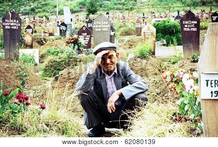 SARAJEVO, BOSINA - MARCH 2: Naim Pasic mourns the loss of his wife and daughter at Lion cemetery on June 2, 1993 in Sarajevo, Bosnia.