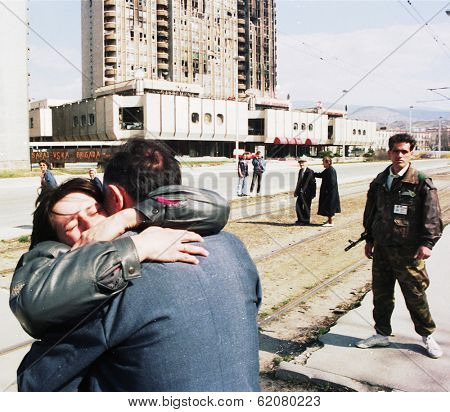 SARAJEVO, BOSNIA - APR 24: A woman collapses in tears after being reunited with loved ones in front of a French UNPROFOR checkpoint in Sarajevo, Bosnia, on Sunday, April 24, 1994.