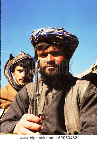 KABUL, AFGHANISTAN - OCTOBER 21: Northfoto Alliance fighters prepare for battle with Taliban forces north of Kabul, Afghanistan on Monday, October 21, 1996