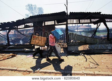 MITROVICA, KOSOVO - JUNE 28: Ethnic Albanian Kosovars loot and burn Serb and Gypsy homes and businesses as part of a large-scale revenge in Mitrovica, Kosovo, on Monday, June 28, 1999.