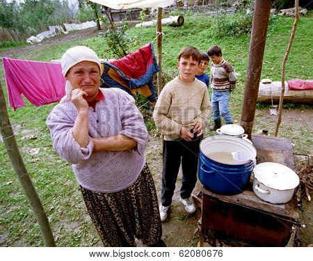 PAGARUSHA, KOSOVO, 05 OCTOBER 1998 - Ethnic Albanian refugees struggle in makeshift camps, away from Serb security forces who have destroyed the majority of villages in Kosovo during fighting.