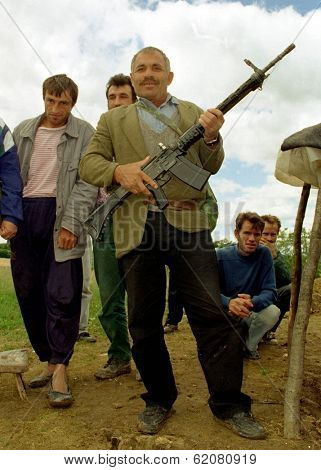 RUDNIK, KOSOVO - JULY 9:  Kosovo Liberation Army (KLA) fighters pause during heavy fighting with Serb security forces for the strategic city of Pec on July 9, 1998 in Rudnik, Kosovo