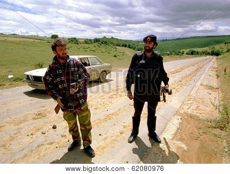 DRENICA, KOSOVO - JULY 7: Guerrillas with the Kosovo Liberation Army (KLA) at a checkpoint near the town of Sirbica on July 7, 1998 in Drenica, Kosovo
