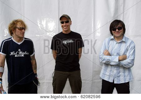 BUDAPEST, HUNGARY - AUGUST 10: Die Aerzte (Die Arzte) perform at the annual Sziget music festival in Budapest, Hungary, on Tuesday, August 10, 2004. From left, drummer Bela B., guitarist Farin Urlaub and bassist Rod Gonzales.