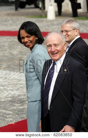 BUDAPEST, HUNGARY - JUNE 22: U.S. Secretary of State Condoleezza Rice, and U.S. Ambassador to Hungary George Herbert Walker, right, await the arrival of President George W. Bush  in Budapest, Hungary, on Thursday, June 22, 2006.