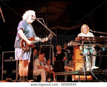 EAST RUTHERFORD, NEW JERSEY - AUGUST 3: The Grateful Dead in concert in East Rutherford, New Jersey, on Sunday, August 3, 1994  At right is keyboardist Vince Welnick.