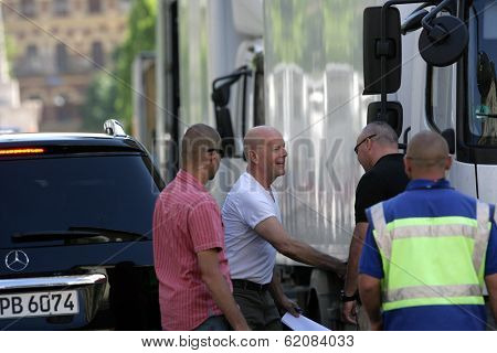 BUDAPEST - MAY 11: Sporting a freshly shaved head, actor Bruce Willis arrives on the set of Die Hard 5: A Good Day To Die Hard in Budapest, Hungary. on Friday, May 11, 2012.