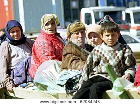 KUKES, ALBANIA, 18 APRIL 1999 --- Kosovar Albanians make their way into a refugee camp along the Albanian border.  Tens of thousands of ethnic Albanians have fled the troubled Yugoslavian provence