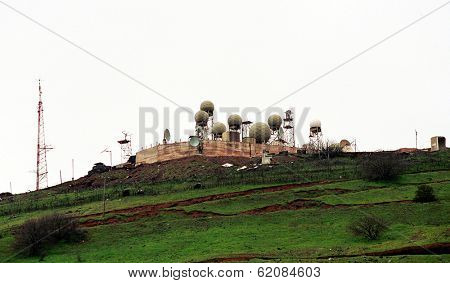 NEVE ATIV, GOLAN HEIGHTS - MARCH 30: An Israeli army early warning station high atop Mount Avital in the Golan Heights faces Syria on March 30, 2000 in Neve Ativ, Golan Height.