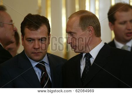 BRATISLAVA - FEBRUARY 25:  Russian president Vladimir Putin, right, speaks with Kremlin chief of staff Dmitry Medvedev in Bratislava, Slovakia, on February 25, 2005.