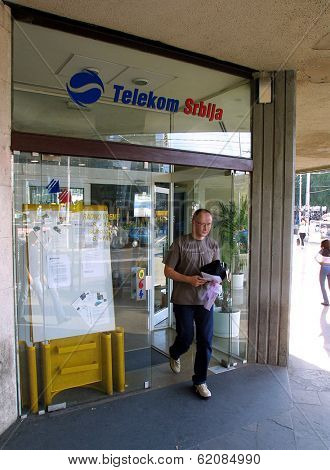 BELGRADE, YUGOSLAVIA, 25 JUNE 2003 A customer exits a Telekom Serbia office in  Belgrade. Serbia, on June 25, 2003. The former state telecom monopoly was privatized in 1999.