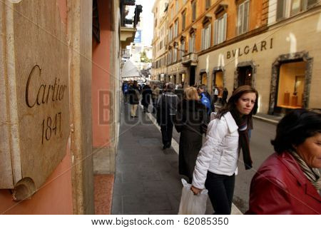ROME - MARCH 13:  Luxury shopping along Via Condotti in Rome, Italy, on March 13, 2005. Shoppers pass between a Cartier and a Bulgari jewelry salon.