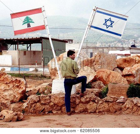ISRAEL-LEBANON BORDER - APRIL 9:  An off-duty Israeli soldier looks across the Israeli-Lebanon border on April 9, 2001.