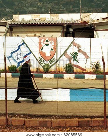 METULA - MARCH 30: A Lebanese cleric walks across the border between Israel and Lebanon at a site called the