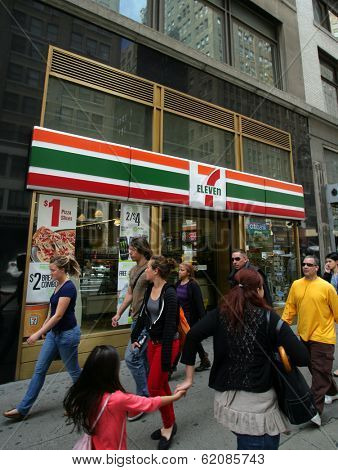 NEW YORK CITY - APRIL 19: People walk past a 7-11 convenience store in New York City, on Friday, April 19, 2013.