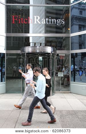 NEW YORK CITY - JULY 11: Pedestrians walk past the headquarters of Fitch Ratings in lower Manhattan on Thursday, July 11, 2013. Fitch Group is a jointly owned by Hearst Corporation and FIMALAC SA