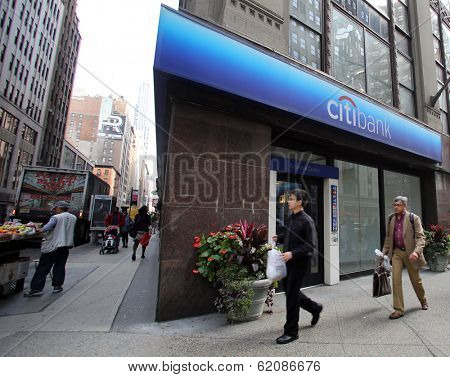 NEW YORK CITY - OCT 20 2013: Pedetrians walk past a Citibank SA retail bank branch in Manhattan on Sunday, October 20, 2013.