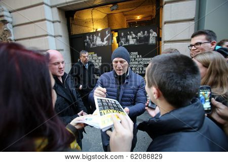 NEW YORK CITY - DECEMBER 28, 2013: Actor Daniel Craig greets fans outside of a Broadway theater where he is starring in a production of the play Betrayal.