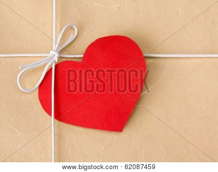 Red heart on a gift box