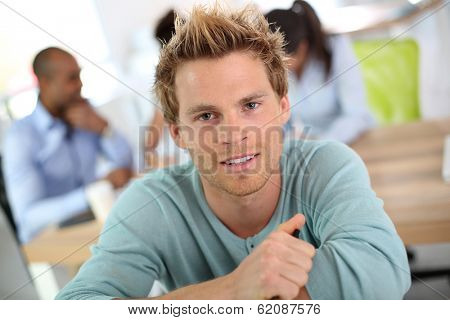 Closeup of young man in business class