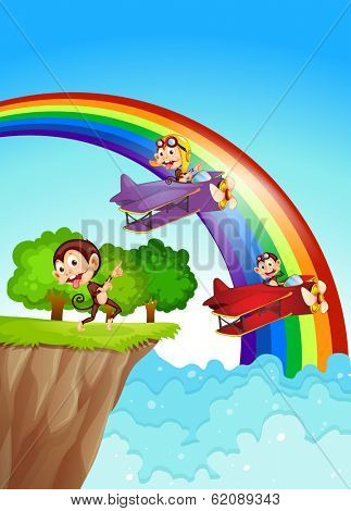 Illustration of the playful monkeys at the cliff with a rainbow