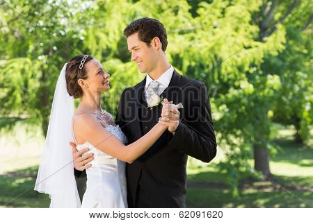Young bride and groom couple dancing on wedding day