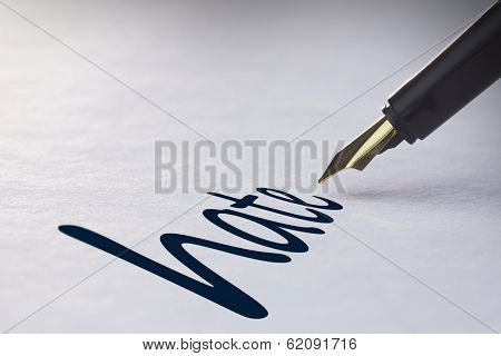 Fountain pen writing the word hate