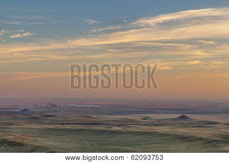 sunset over prairie in northern Colorado near Fort Collins with a distant power plant