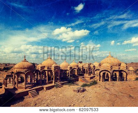 Vintage retro hipster style travel image of Bada Bagh cenotaphs ruins, Jodhpur, Rajasthan, India with grunge texture overlaid