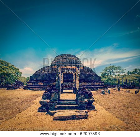 Vintage retro hipster style travel image of ancient Buddhist dagoba (stupe) Pabula Vihara. Ancient city of Pollonaruwa, Sri Lanka