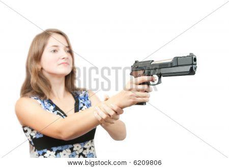 Girl Aiming A Black Gun. Focus On Gun Only