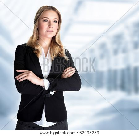 Serious business woman in the office, modern building of great corporate, successful career, smart girl working in luxury business center
