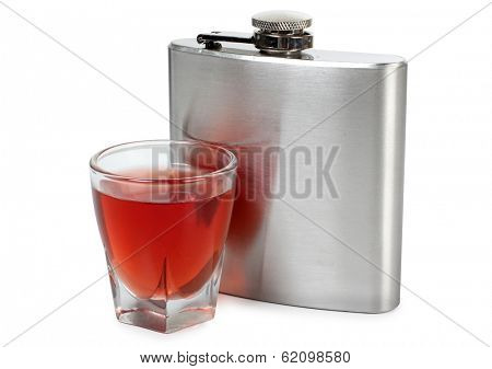 Flat metal flask and whiskey glass on white background