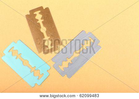 Razor blades on color background