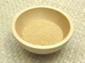 Wooden Bowl With Amaranth On Rattan Underlay