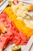 image of fruit platter  - Sliced fruit platter on stainless steel tray - JPG