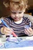 picture of finger-painting  - Toddler boy child drawing finger painting making art  - JPG