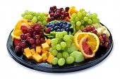 stock photo of fruit platter  - Isolated platter of assorted fruit and cheese - JPG