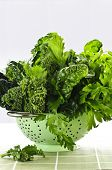 pic of roughage  - Dark green leafy fresh vegetables in metal colander - JPG
