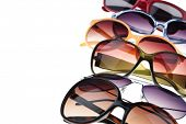 stock photo of protective eyewear  - Assorted styles of tinted sunglasses on white background - JPG