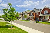 picture of suburban city  - Suburban residential street with red brick houses - JPG
