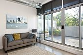 image of windows doors  - Living room with sliding glass door to balcony - JPG