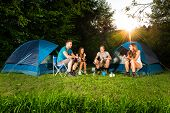 stock photo of kettles  - cooking on a camping with a group of young friends - JPG