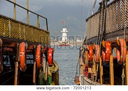 Vintage sailships and Lighthouse in the port of Alanya Turkey.