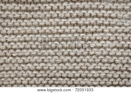 Knit texture of undyed natural brown alpaca wool knitted fabric with garter stitch pattern as background